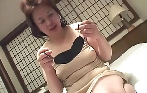 Oriental granny inserts a marital-device on every side her twat