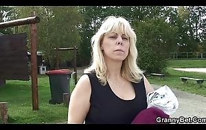 Aged kermis granny rides cock on public