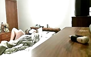 My mum masturbates on bed. Hiddden web camera